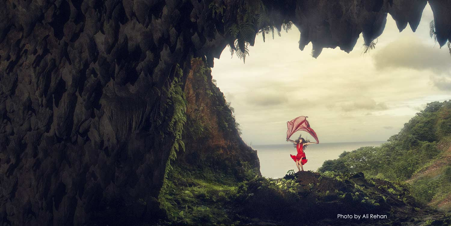 Animation of girl waving fabric on top of a mountain