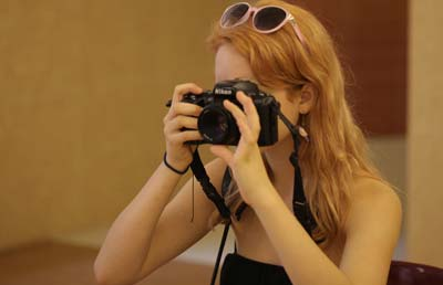 Student takes a photograph with a Nikon camera