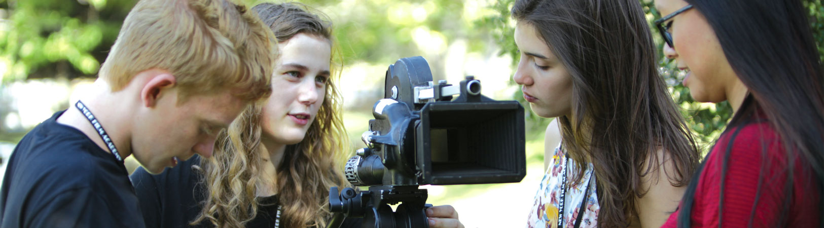 Four NYFA Students talking while working on filming a scene